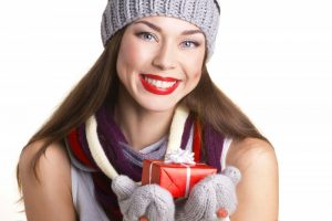 woman smiling winter christmas present