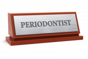 "A plaque with ""periodontist"" engraved on it."