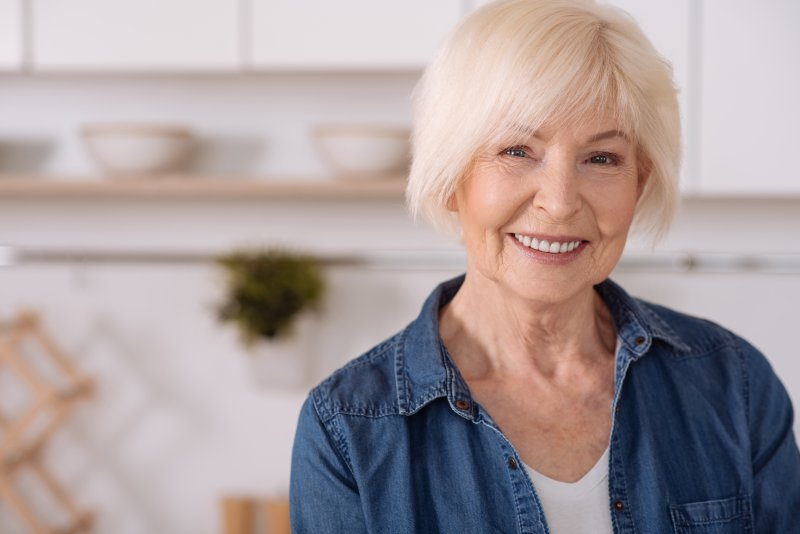 older woman enjoying increased bone density and dental implant success